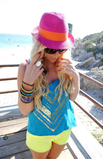 Pink Neon Hat, Blue Shirt, Bangles, Yellow Neon Shorts