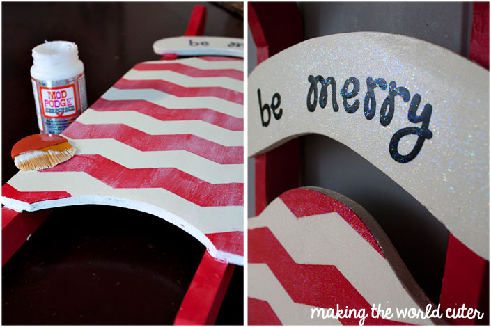 Using Mod Podge Glitter to add some bling and sparkle to a Christmas sled decoration on Making the World Cuter
