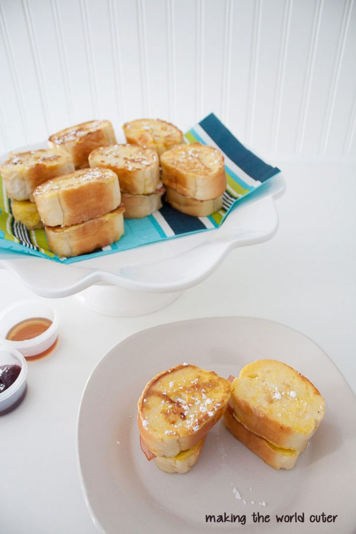 French Toast Sliders. Yum! Cream cheese, canadian bacon and dip it in syrup or jam. These would be great to bring to a potluck brunch!