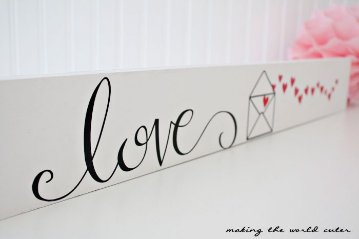 Valentine Love Letters wall with heart stockings and a super cute love letters vinyl sign.