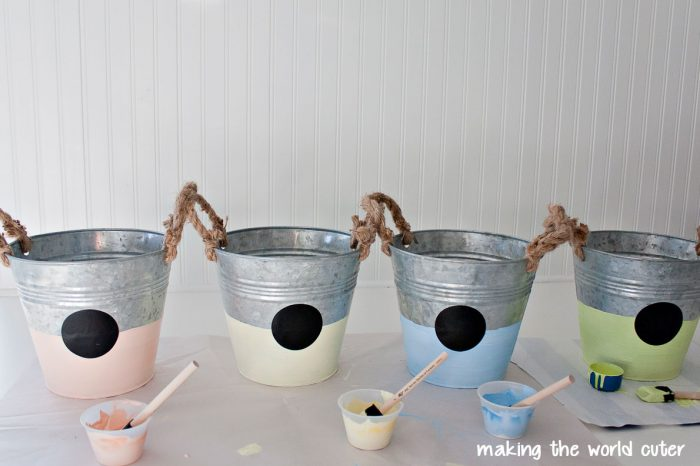 Personalized Easter Buckets using white chalk paint that was colored with acrylic paints to make some pretty pastel colors. Vinyl and a chalkboard marker make these personalized and super cute!