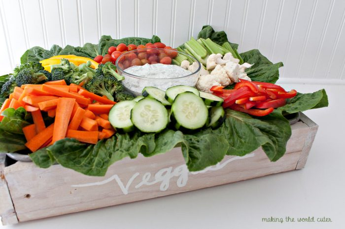 DIY Veggie Tray that makes such a CUTE statement! Super easy to put together using a pan as the base and underneath is storage for extra veggies or for transporting to a party. LOVE!