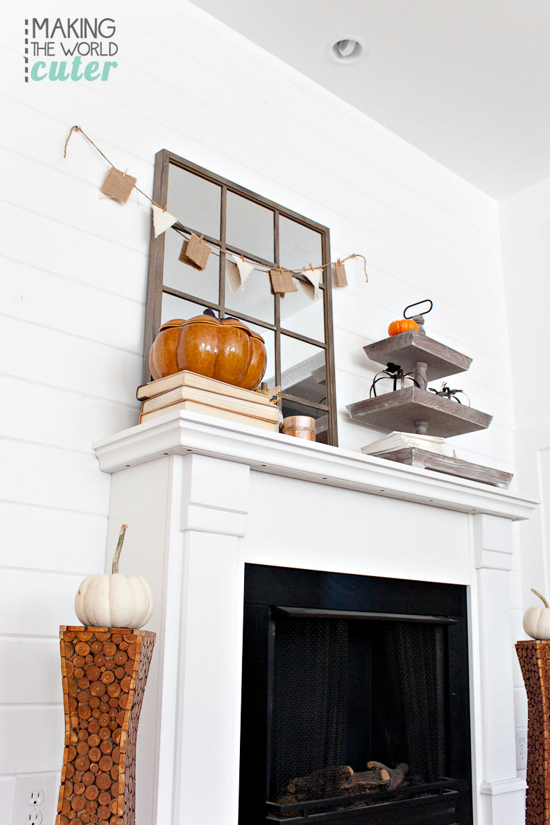 Natural looking fall mantel that is super pretty and nice for Halloween and will work well right into Thanksgiving.