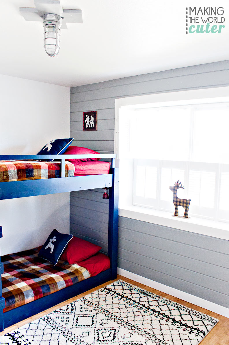 Boys Bunk Room Camping/ Lodge Theme. Super cute navy blue bunk beds, plantation shutters, plaid decorations and that gray plank wall is amazing! I love shiplap!
