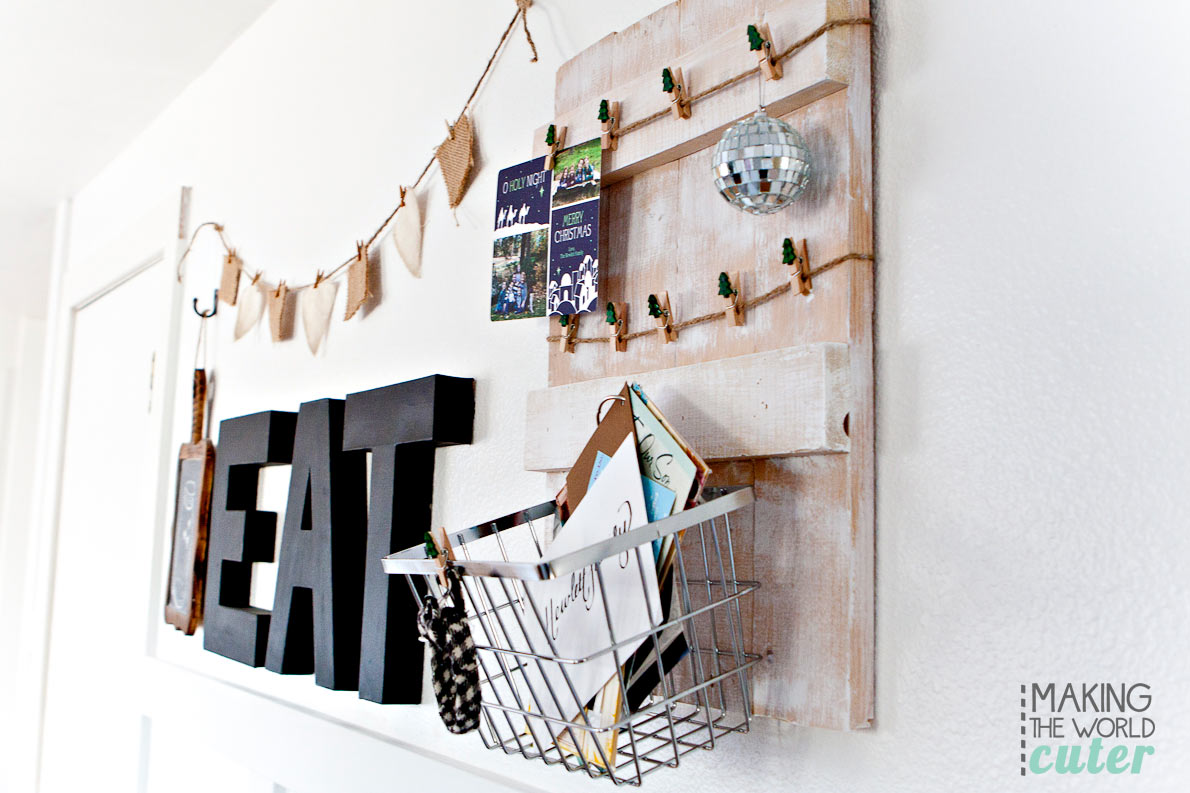 Rustic DIY Christmas Card Holder with basket to hold the cards that don't need displaying. After Christmas you could totally use this as a kitchen command center! This would be cute on a mantel or hanging on the wall, and an easy build!