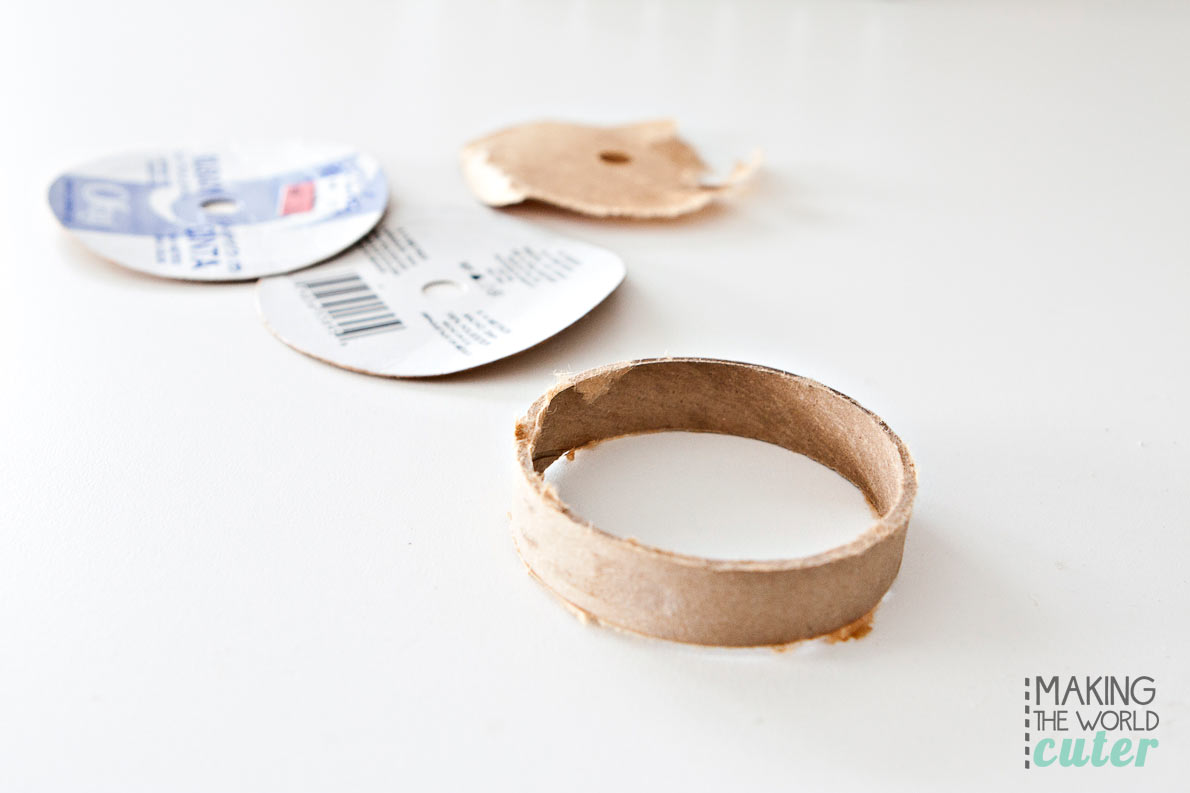 A simple trick to making perfect miniature wreaths? Take apart a used ribbon spool!