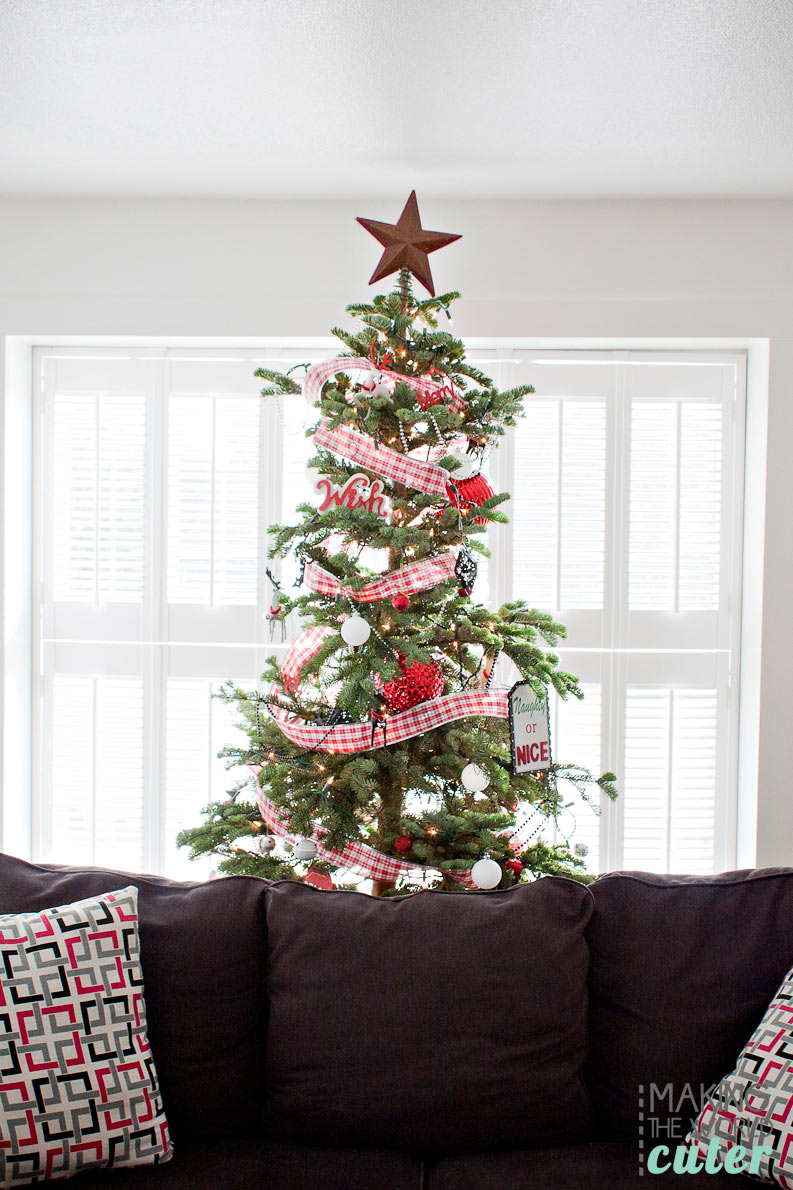 Making the World Cuter Christmas Home Tour, including Christmas mantel decor, kids own Christmas trees with themes (LOVE THESE), advent stockings and more. Super cute!