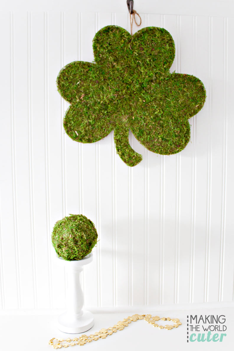 DIY Shamrock covered in moss. Easy St. Patrick's Day craft for a cute wreath, door hanging or for cute mantel decor, also a bonus project-a diy moss covered decorative ball.