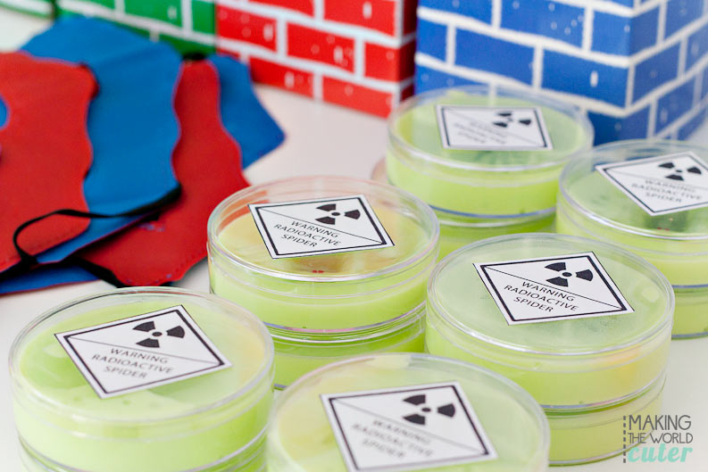 DIY Radioactive Spider Slime with free printable. Super cute for a superhero birthday party or play date.