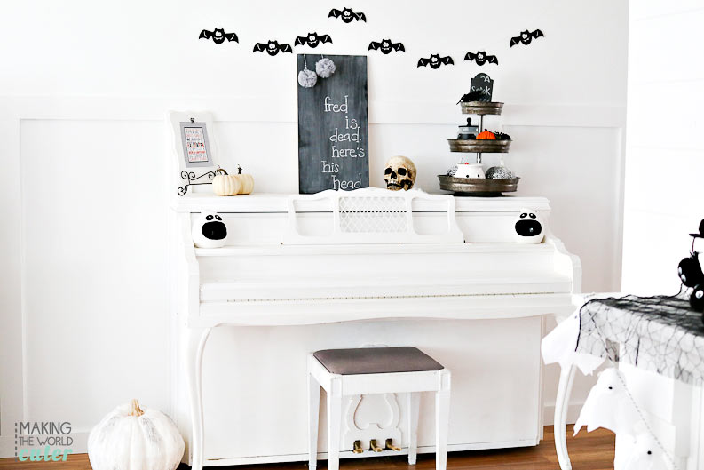 Darling black and white Halloween decor for the mantel and piano. Be sure to check out the 3 tiered metal tray, all decked out for the holiday! Love!