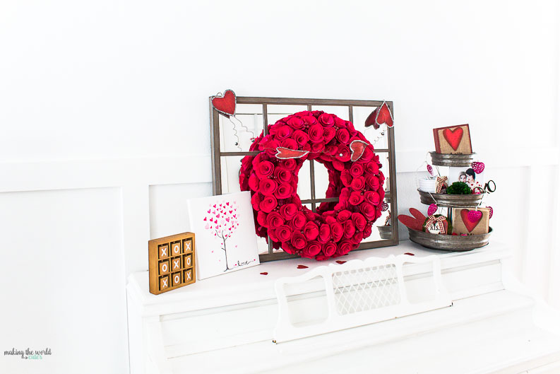 Get inspired with these cute Valentine Mantel Decor and other home decorating ideas! Love the 3 tiered tray decorated for the holiday and the shiplap wall behind the fireplace.