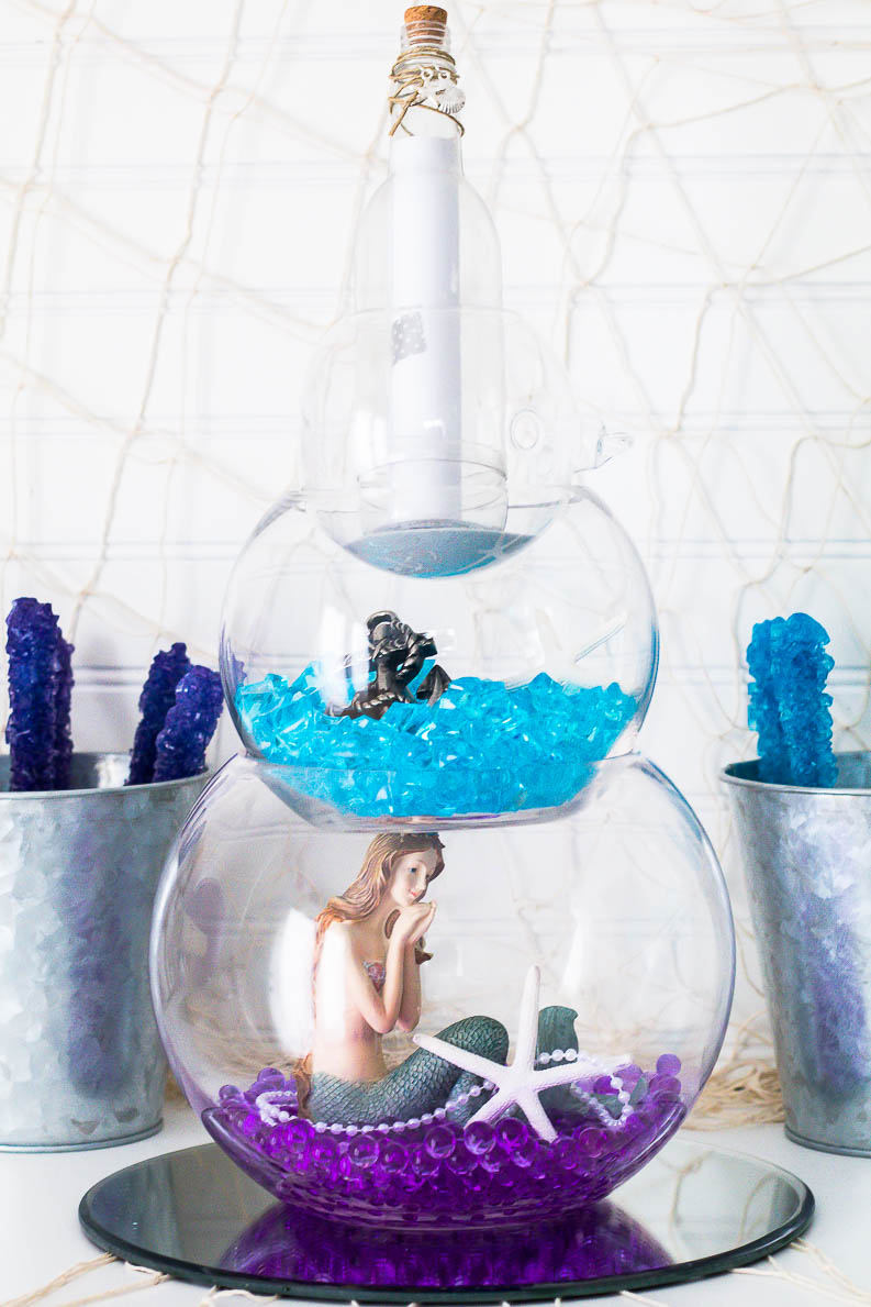 Mermaid or Fisherman Gender Reveal centerpiece with the actual gender reveal in the message in a bottle! The gender reveal is a darling free printable.