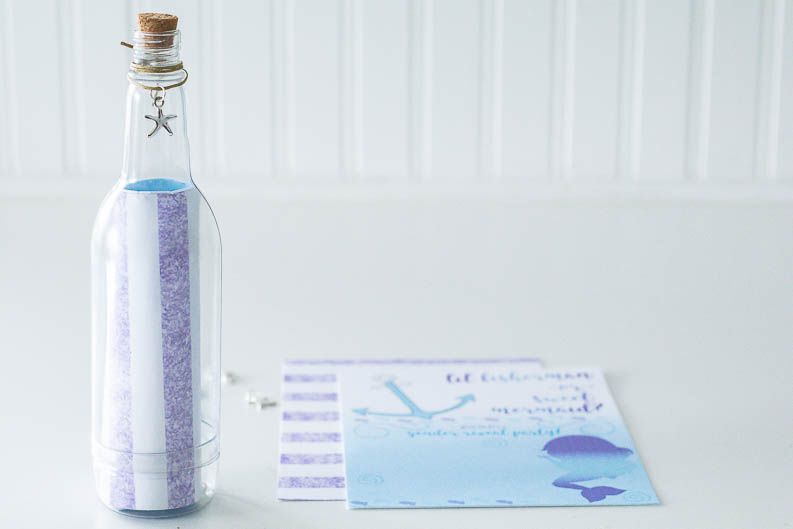 Mermaid or fisherman gender reveal party message in a bottle invites.