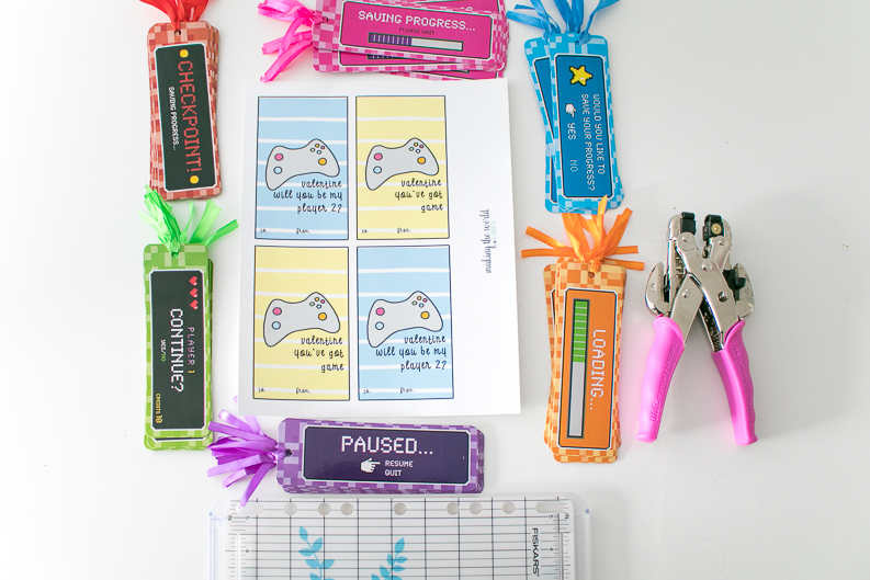 Video Game bookmarks, video game valentine's day cards, hole punch, paper trimmer, supplies.