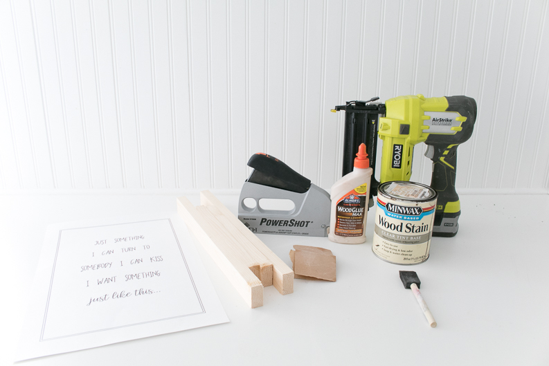 Supply shot for project, nail gun, wood glue, stain, stapler, wood, print, sandpaper