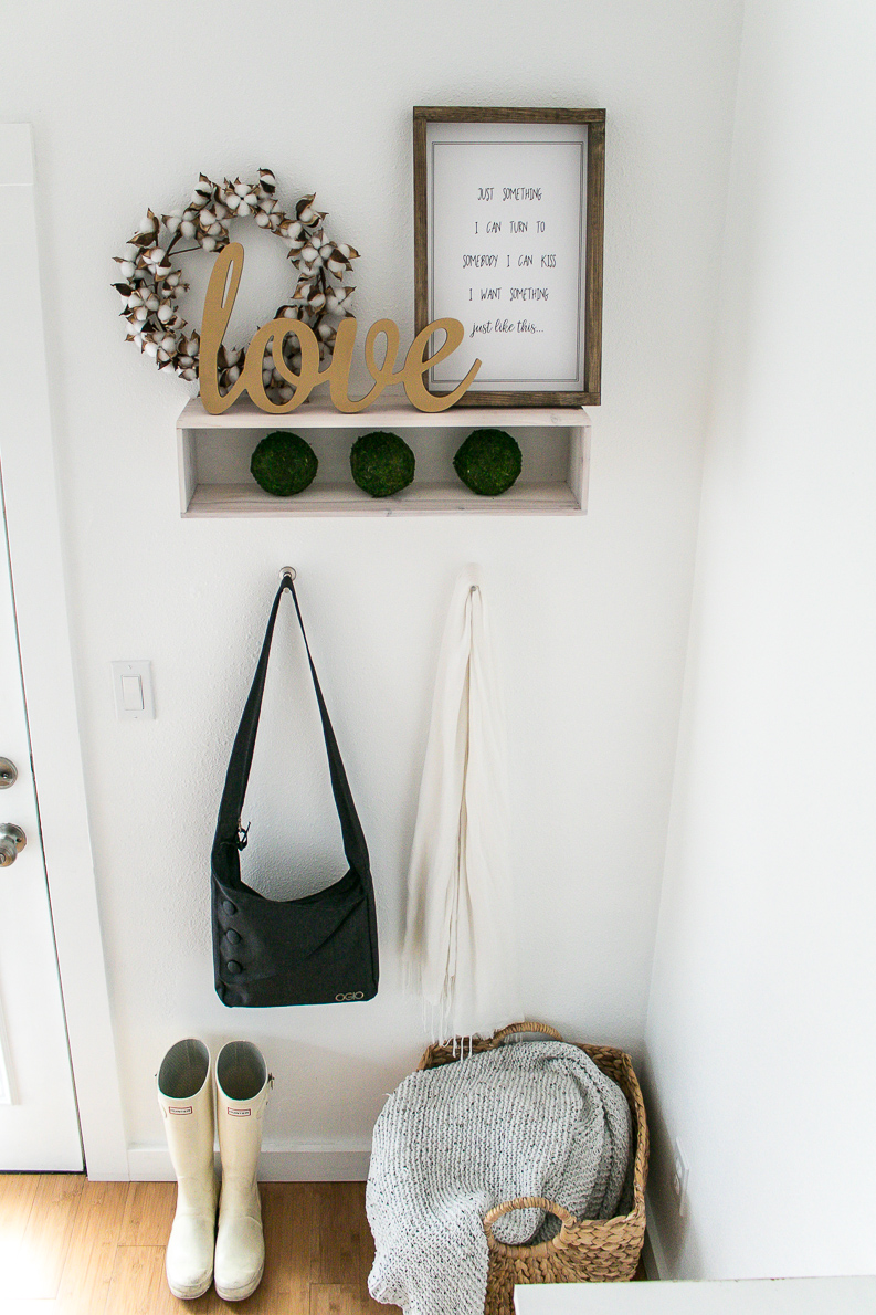 Cute farmhouse style entryway with Music Lyrics Print, hunter boots, love sign and cotton wreath