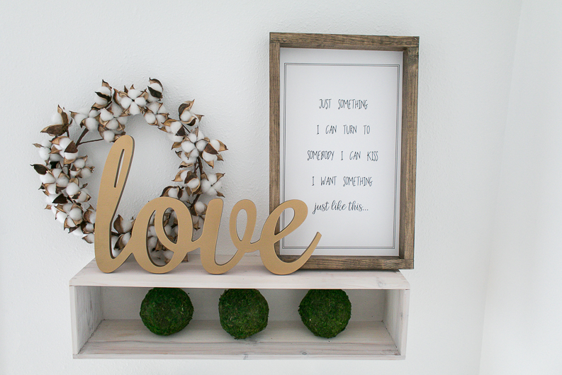 Music Lyrics Print on shelf with moss balls, wooden calligraphy love sign and cotton wreath