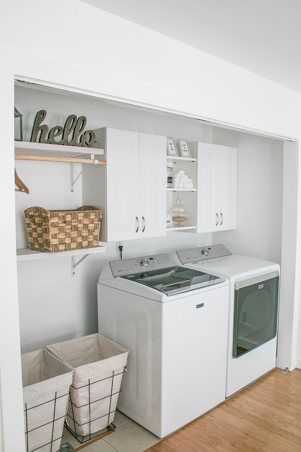 Laundry Room Remodel with White Cabinets and Farmhouse Style