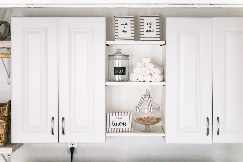 Laundry Room Shelf Decor Glass Jars, Wash Cloths and Laundry Themed Prints