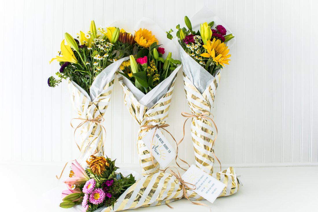 How to gift wrap flowers that you get from the grocery store, and make them look professional and CUTE! With free printable gift tags!