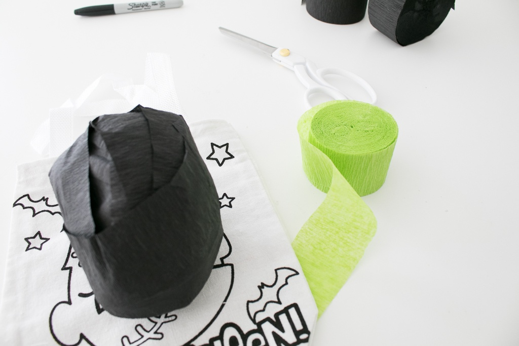 Adding a trick or treat bag to Frankenstein's Monster Surprise Ball