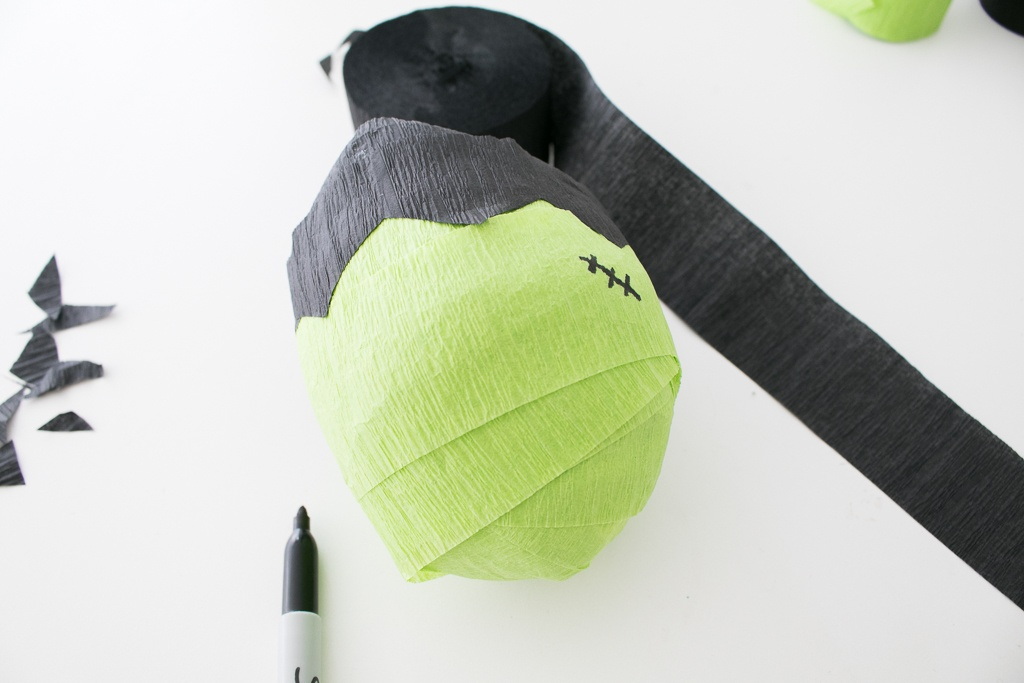 Adding stitches on Frankenstein's Monster Surprise Ball
