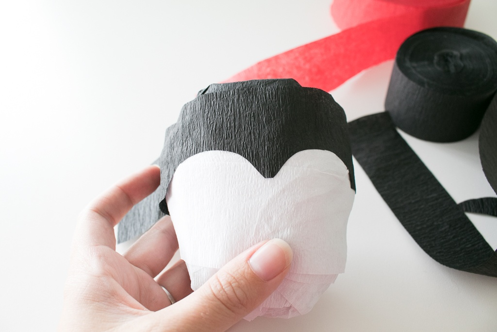 Gluing on Dracula Hair on a vampire surprise ball