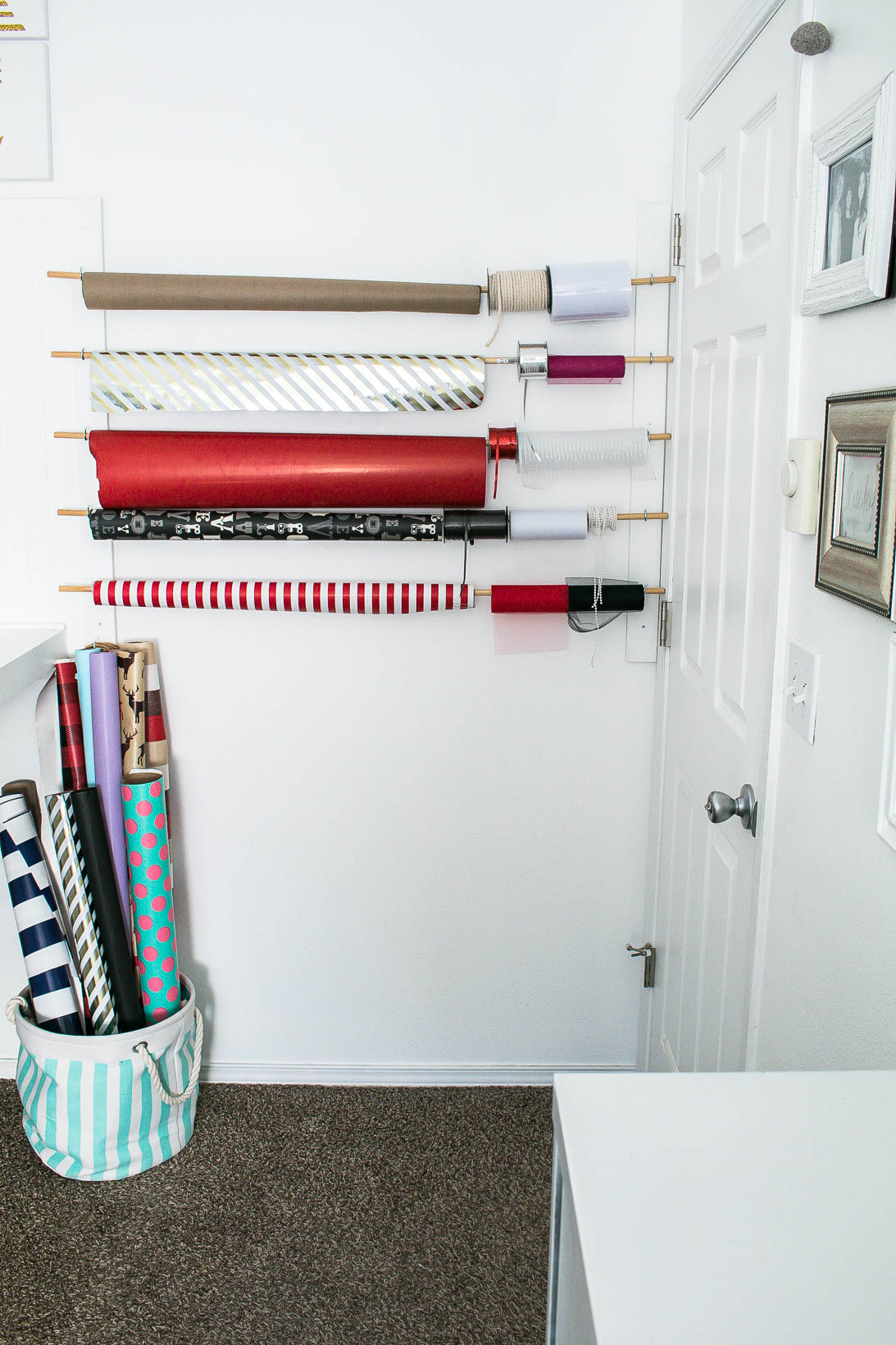 Wrapping paper gift wrapping station in Organized white craft room