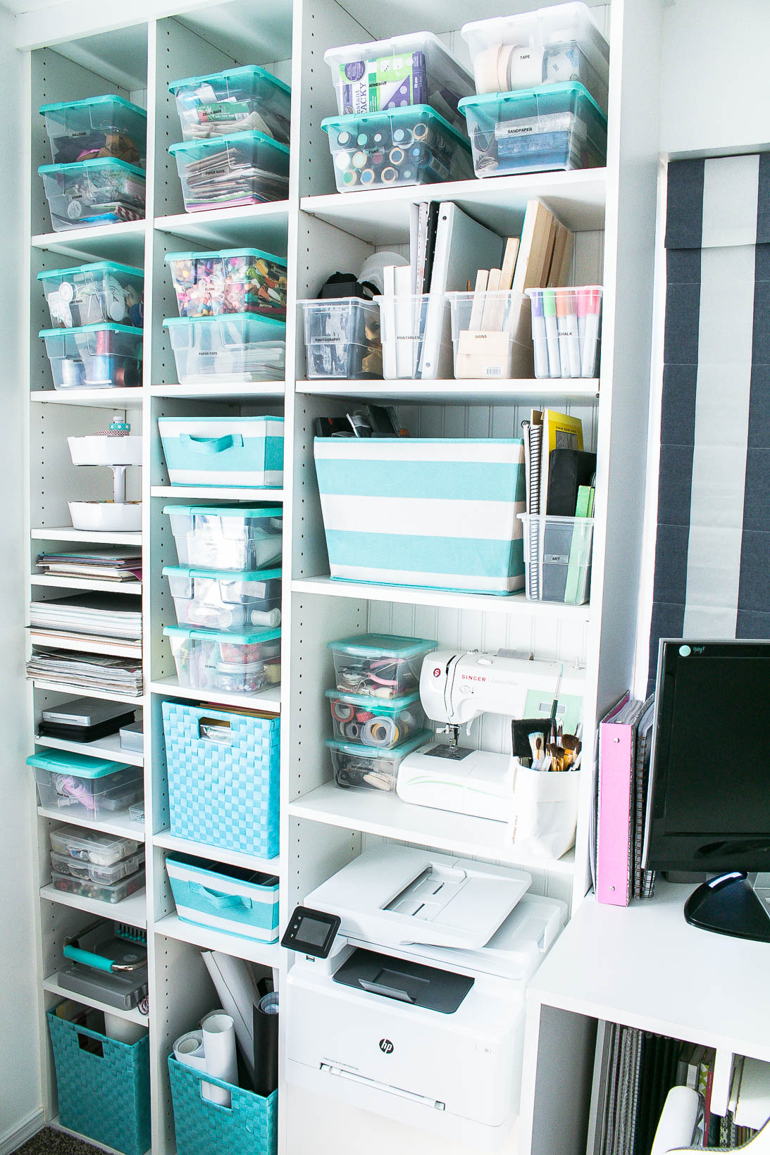 Shelves in Organized white craft room