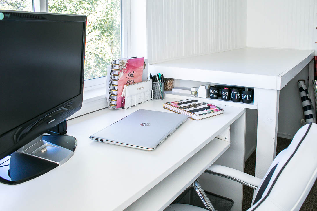 Desk in organized white craft room