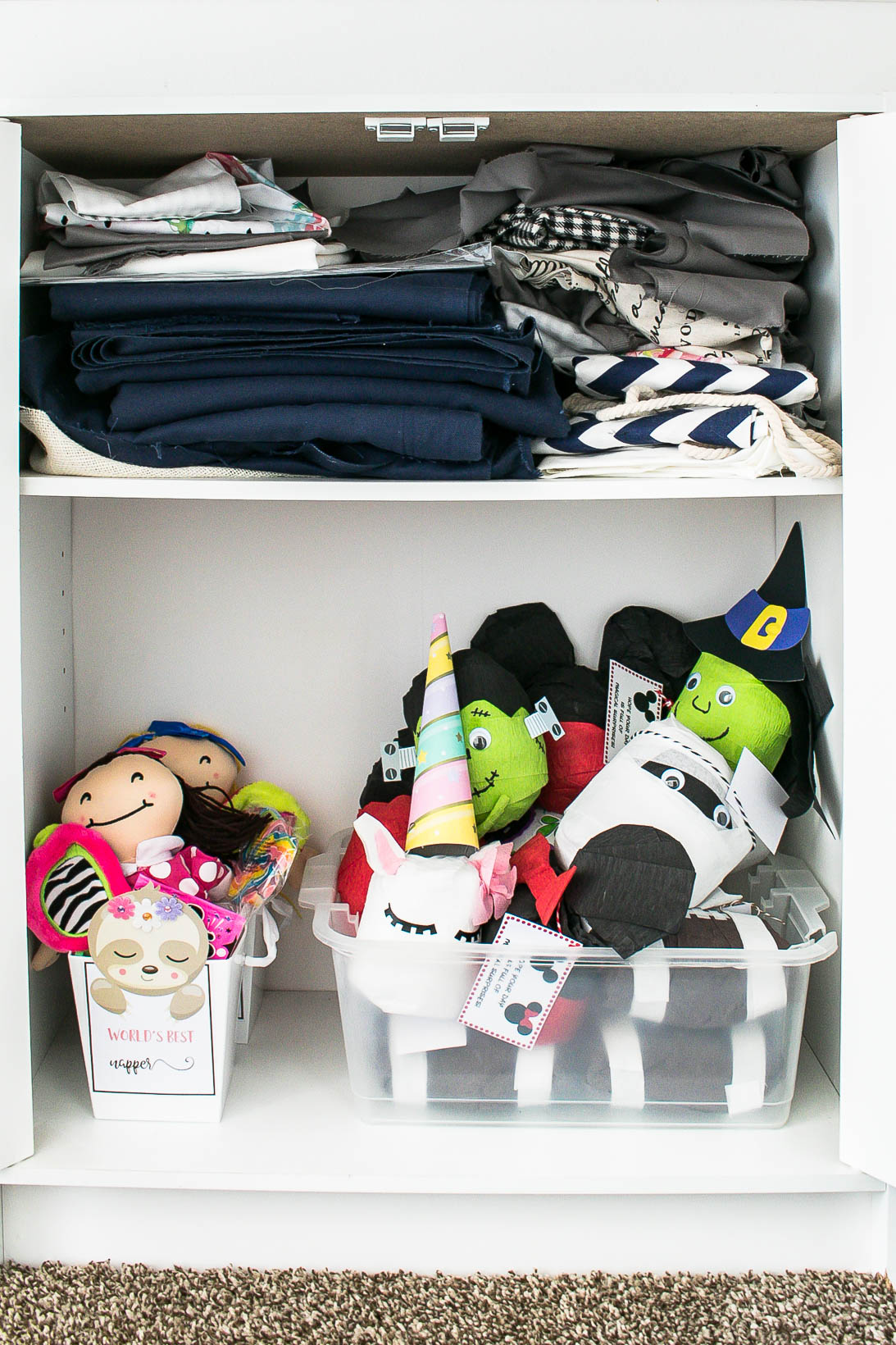 Fabric and gift storage in organized white craft room