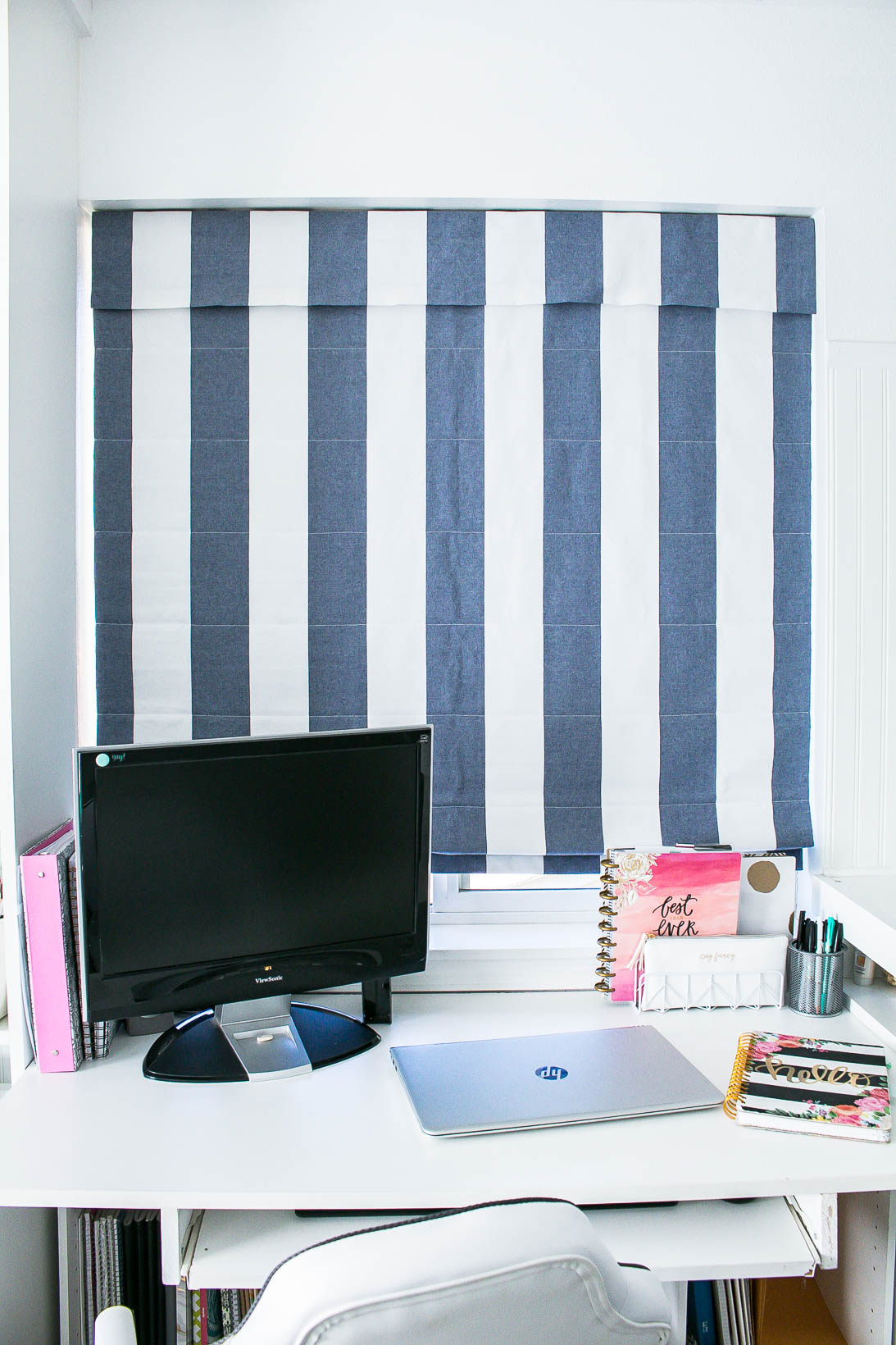Roman shade blinds in Organized white craft room