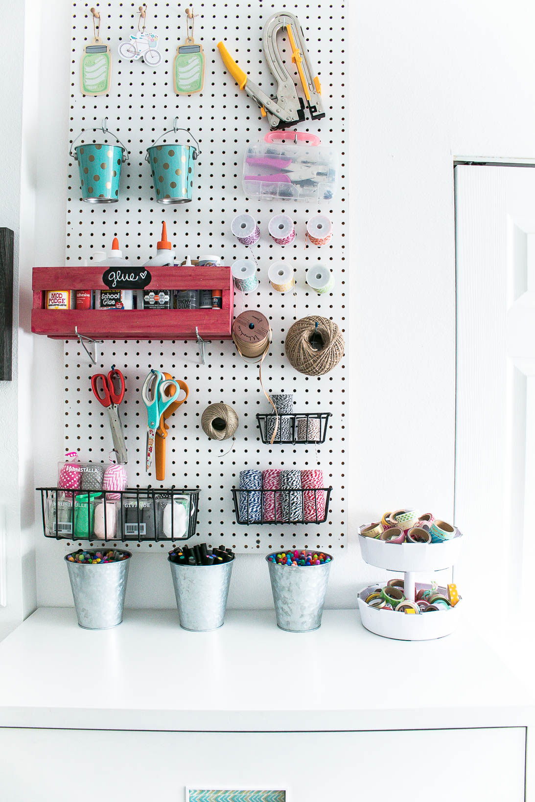 Pegboard in Organized white craft room