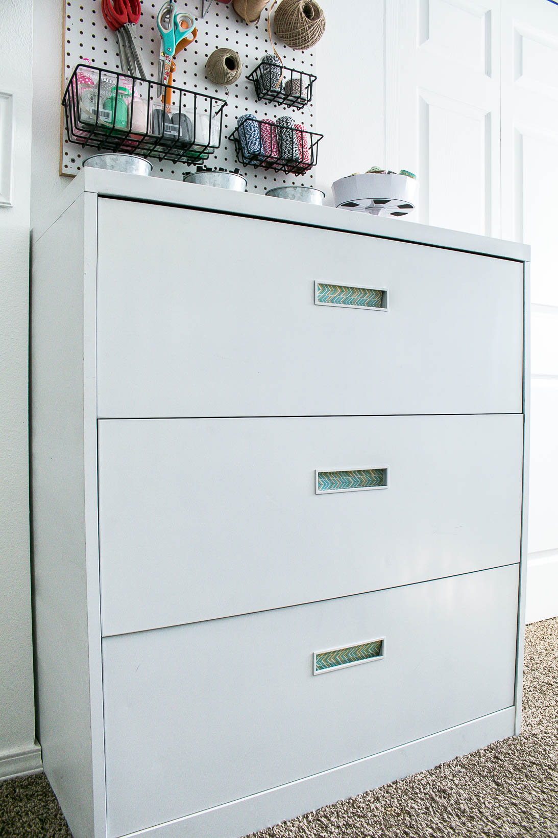 Filing cabinet in Organized white craft room