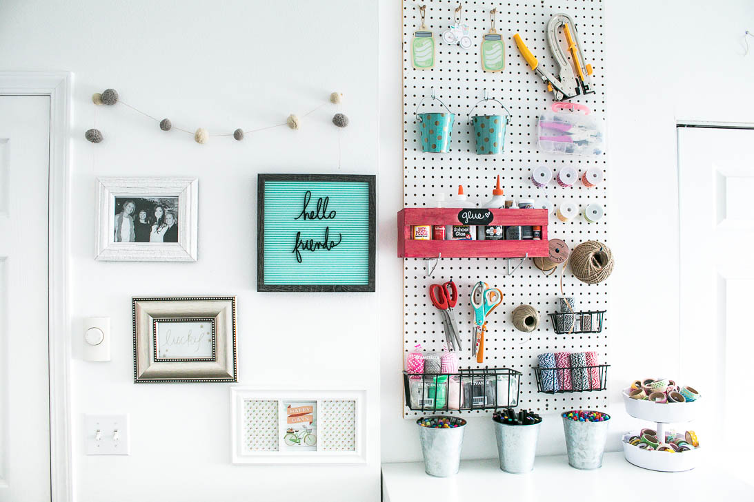 Gallery wall and peg board in Organized white craft room